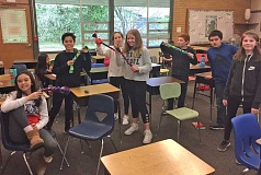 SUBMITTED PHOTO: SUSAN STEGER - Lakeridge Junior High School students participated in community service activities in between state standardized tests. Activities included making dog toys out of fleece strips for the Oregon Humane Society's shelter in Portland.