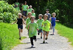REVIEW PHOTO: VERN UYETAKE - During the Westridge Walk-a-thon on May 4, a group of kindergartners complete a lap around the field.