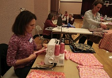 TIMES PHOTO: JAIME VALDEZ - Volunteers sew fabric bags for Days for Girls at the Tualatin LDS Stake Center on Friday.