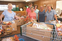 PEGGY SAVAGE - A group of volunteers keep things running smoothly at the Molalla food bank