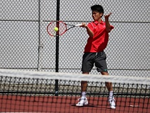 REVIEW/NEWS PHOTO: JIM BESEDA - Clackamas' Seth Lee dropped a 6-3, 6-1 decision to Central Catholic's Joey Schwartz in Wednesday's Mt. Hood Conference boys' tennis sistrict singles final at David Douglas High.