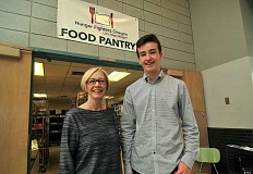 REVIEW PHOTO: VERN UYETAKE - Lake Oswego High School freshman Michael Murray beams with his food pantry director, Linda Mathes.