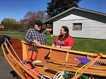 SUBMITTED PHOTO - Packard 'Pack' Phillips meets with Centennial Little League President Jennifer Clark to pass off his McKenzie River drift boat, which he donated to the league to raise funds for its softball program.