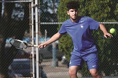 PHIL HAWKINS - Woodburn senior Levi Samano joined with doubles partner Trevor Karsseboom to place fourth at the Mid-Willamette Conference tennis tournament to earn a trip to the state championships this week.