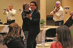 JULIA COMNES - Elias Villegas, dean at Chemeketa Woodburn Center, dances with Susan Murray, executive dean, at a retirement party at the Woodburn Center Friday.