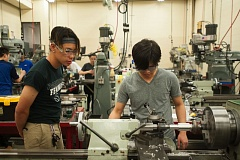 OUTLOOK PHOTO: JOSH KULLA  - Students at Mt. Hood Community College work in the machine shop.