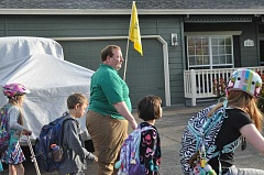 Tigard Mayor John Cook walks to Mary Woodward Elementary with students as part of 'Walk and Bike to School Day.'