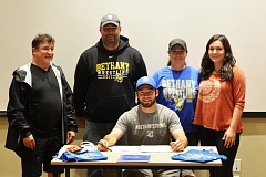 SPOTLIGHT PHOTO: JAKE MCNEAL - Lions senior Zach Gadbois, center, joined by, from left, coach Scott Revis of USA Cobra Wrestling, Zach's father and St. Helens' current wrestling coach, Greg, mother Amy and sister Sierra, gathered to witness Zach's announcement of intent to attend and wrestle for NAIA Region IV Bethany College (Lindsborg, Kansas) on Wednesday in the Loo Witt Room at St. Helens High.