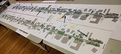 REVIEW PHOTO: ANTHONY MACUK - Partcipants in last week's community meeting got a chance to study a large map of the entire length of D Avenue, so viewers could compare designs and make notes about specific areas of concern.