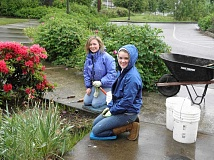 SUBMITTED PHOTO  - Gina and Leah Olson are getting a head start on Take Care of West Linn Day by sprucing up around the West Linn Adult Community Center.