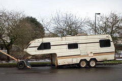 FILE PHOTO - An illegally parked camper sits near Clear Creek Middle School.