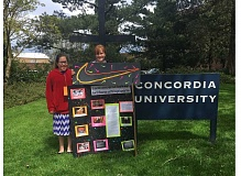 SUBMITTED PHOTO - JCMS students Raylene Alire, left, and Brook Hughes display their History Day project at Concordia University.