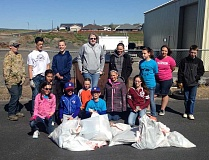 SUBMITTED PHOTO - Members of the Culver Livestock Club pose with the bags of trash they collected during a cleanup in Culver.