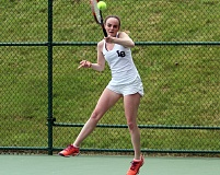 PMG PHOTO: MILES VANCE - Lake Oswego's Anna Lowy (here in Saturday's doubles championship match) and partner Melisha Dogra helped the Lakers win their second straight Class 6A team championship at the Babette Horenstein Tennis Center in Beaverton.