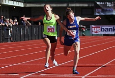 PMG PHOTO: MILES VANCE - Jesuit's Makenna Schumacher (left) edges Barlow's Olivia Johnson by .02 seconds to win the 3,000 meters title during the Class 6A state track meet on Friday at Hayward Field in Eugene.