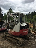 PHOTO COURTESY OF THE COLUMBIA COUNTY SHERIFF'S OFFICE - A stolen excavator was recovered at a Rainier residence last week. Columbia County Sheriff's Office deputies served a search warrant last week and discovered the piece machinery and other stolen building materials.