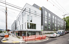 PORTLAND TRIBUNE: JONATHAN HOUSE - The new St. Francis Park Apartments occupy a full block on Southeast Stark Street between 11th and 12th avenues.