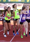 TRIBUNE PHOTOS: JONATHAN HOUSE - Jesuit High's Lena Colson (left) gets the baton from Hallie DeVore for the final leg of the girls 4x400 relay Saturday at Hayward Field.