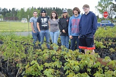 SPOTLIGHT PHOTO: NICOLE THILL - Columbia River Corps students Cole Benshoof, Dylan Lobby, Gloria Montoya, William St. John, Skyler Sample and Jared Swatski stand in the school's native plant nursery. The students work on conservation programs throughout the school year including the native plant nursery.