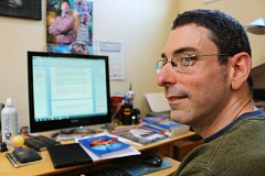 OUTLOOK PHOTO: ZANE SPARLING - Writer Nick Lang sits in front of the computer he used to write 'The Lost Angels.' The first draft was started in 1999, though Lang says every sentence has been rewritten since then.