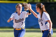 OUTLOOK PHOTO: JOSH KULLA - Barlow outfielder Timber Swindell gets a high five from teammate McKenzie Pierce Monday following an acrobatic catch in the Bruins' 9-0 first round 6A state playoff win over visiting Sheldon (Eugene) High School.