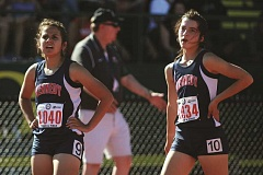 PHIL HAWKINS - Kennedy distance runners Alejandra Lopez (left) and Kaylin Cantu scored 24 of the girls team's 26 points at the 2017 2A State Track and Field Championships on Thursday and Friday, placing the Trojans ninth overall in the team standings.