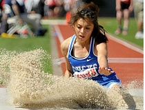SETH GORDON - St. Paul senior Jennifer Hernandez splashes into the triple jump pit Friday at the 2A state meet in Eugene. Hernandez set a new PR (34-1.25) to place fourth in the event, as the Bucks finished 11th as a team.