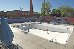 PORTLAND TRIBUNE: JAMIE VALDEZ - Construction workers prepare to paint lanes at the Grant outdoor pool. Improvements to the pool are included in the parks replacement bond.