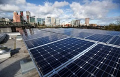 PAMPLIN MEDIA PHOTO: JON HOUSE - Solar panels sit on the roof of  Firestation 21 along the Willamette River in Portland. Should SolarWorld close, industry leaders say, there are other options for workers in high-tech manufacturing.