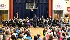 SUBMITTED PHOTO: COURTESY OF LOHS - Lake Oswego High School teacher Andrew Desmond directs the Wind Ensemble during a performance for the Forest Hills Elementary School Falcons at a recent visit.