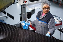 PHOTO COURTESY OF SOLARWORLD AMERICAS - A worker prepares solar modules at SolarWorld's Hillsboro plant.