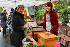 DAVID F. ASHTON - At the last Woodstock Farmers Market of the 2015 season, neighbor Alison Dow buys fresh produce from Katy McDonald of Big B Farms down the valley in Aurora.