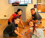 ELIZABETH USSHER GROFF - Aiden, Keiya, Mariko and Jake Harris - all Tae Kwon Do students at the Woodstock Community Center - helped prep the Centers mirror room for painting. The next day, eight New Seasons employees joined Friends of the Woodstock Community Center volunteers to paint the room.