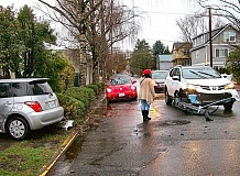 RITA A. LEONARD - Drivers of three cars that slid into each other in the rain conferred and checked the damages, just north of Garthwick, on December 12th in Sellwood at S.E. 13th and Linn Street. Pix #4-10: Two vehicles in 3-car wreck were more seriously damaged.