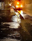 DAVID F. ASHTON - A water main break on S.E. Powell Boulevard near 75th Avenue caused water to gush from cracks in the pavement before it was swiftly repaired.