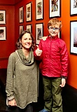 DAVID F. ASHTON - During the January Artists Reception, Lewis Elementary first/second grade teacher Jill Brenan stands with student Enzo Luperini, who started the whole idea of holding shows and making sales to support the schools arts programs.