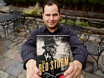 TIMES PHOTO: JAIME VALDEZ - Beaverton resident Grant Bywaters holds his first book  'The Red Storm,' which was published in December.