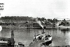 COURTESY OF SMILE HISTORY COMMITTEE - An unnamed photographer captured for history the final crossing of the Sellwood Ferry, The John Caples, on December 15, 1925. The nearby barge is loaded with sawdust from the adjacent East Side Lumber Mill.