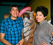 RITA A. LEONARD - At Rocios Mexican Restaurant on S.E. Gladstone Street, the site of a recent successful Grout School fundraiser, Shift Manager Iraq Camacho and owner Rocio Meza flank the wooden el tigre statue in the entryway.