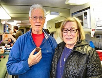 ELIZABETH USSHER GROFF - Inside the Red Cross Bloodmobile, during a visit to Holy Family School, are donor Dave Robinson - and donor coordinator Miki VanHouten, at right. As is evident here, VanHoutens homemade cookies are a popular reward for donors.