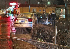 DAVID F. ASHTON - This Honda crashed into a light pole, after leaving the traffic lane on 82nd Avenue and smashing through a fence near S.E. Flavel Street. The driver was found by police to be intoxicated.
