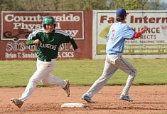 ESTACADA NEWS: DAVID BALL - Estacada's Orion Alexander speeds around second base after an Andy Avants single in the second inning of Friday's 2-1 win over Madras.