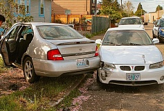 DAVID F. ASHTON - Police and Fire responded to the Woodstock intersection where a GMC Yukon SUV had apparently run a stop sign and crashed into a Nissan Altima - causing it to careen into another car, through a fence, and into a yard.