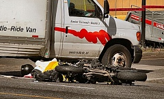 DAVID F. ASHTON  - Damage to the box of the U-Haul truck was minimal, but the speeding motorcycles impact into its side killed the rider.