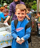DAVID F. ASHTON - Joe Barter had fun making a Clay Dumpling seed ball at the Llewellyn Earth Day observance.