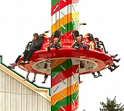 DAVID F. ASHTON - Guests at Oaks Amusement Park try out the new family-friendly Tree Top Drop thrill ride.