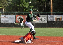 TIMES PHOTO: MILES VANCE - Jesuit shortstop Chris Arpan turns a double play during his team's 4-3 win over Beaverton at Jesuit High School on Friday.