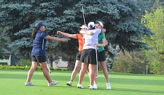 TIMES PHOTO: MATT SINGLEDECKER - Jesuit junior Amy Wagner, Sunset senior Ellen Secor, Westview freshman and Beaverton girls golfer Nicole Posner share an embrace during the Apollos win at Rock Creek Country Club on Thursday.