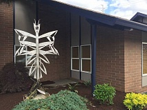 GEOFF PURSINGER - An abstract butterfly statue installed outside Tigard Chiropractic this month is meant to symbolize the downtown's efforts to grow and change into something new, business owner Donna Erdman says.