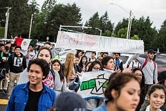 TIMES PHOTO: JONATHAN HOUSE - Tigard High School students march across the school's parking lot in support of a large walk out of students at Forest Grove High School